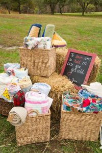 Blankets for ceremony, stay warm by giving guest blankets, how to keep guests warm during fall ceremony