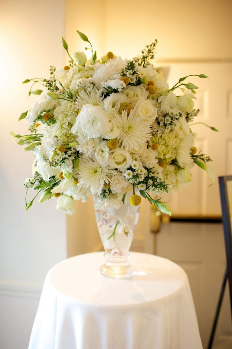 white tall arrangement with yellow pops of color
